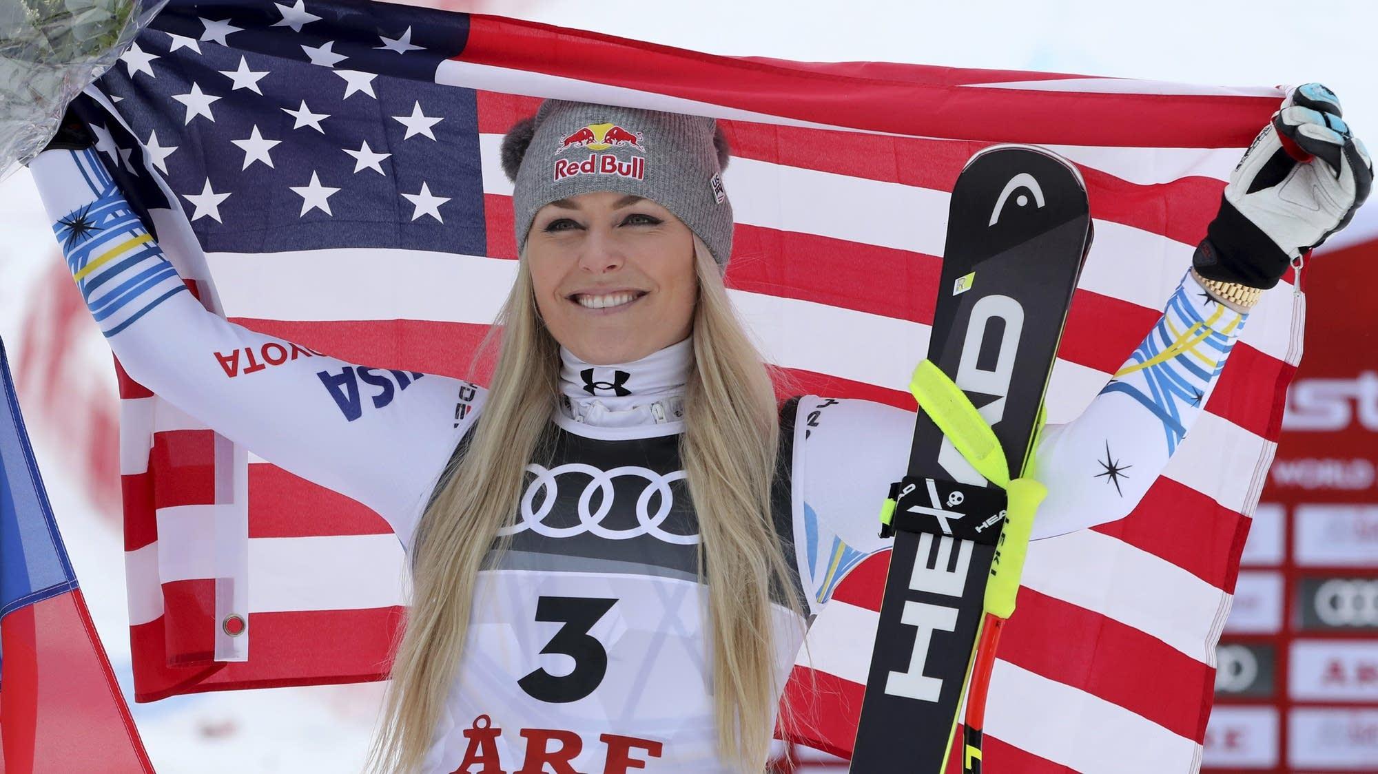 Lindsey Vonn of the U.S. celebrates after winning a bronze medal
