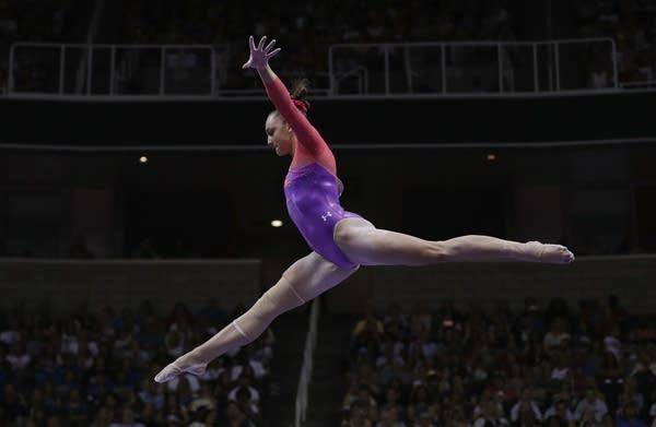 Maggie Nichols competes on the balance beam