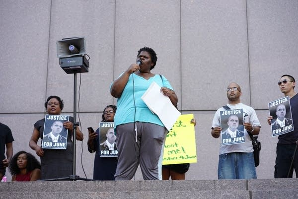 Darlynn Blevins, Thurman Blevins' sister speaks at a protest.