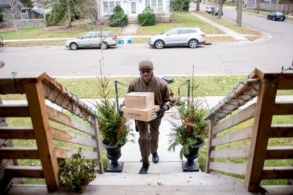 UPS driver Demone Eady delivers packages.