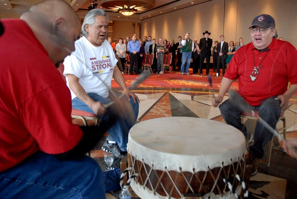 Beating a drum