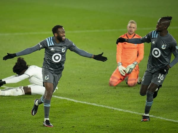 Minnesota United midfielder Kevin Molino celebrates his second goal