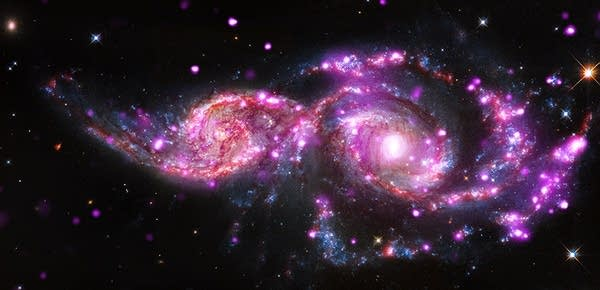 Spiral galaxies NGC 2207 and IC 2163