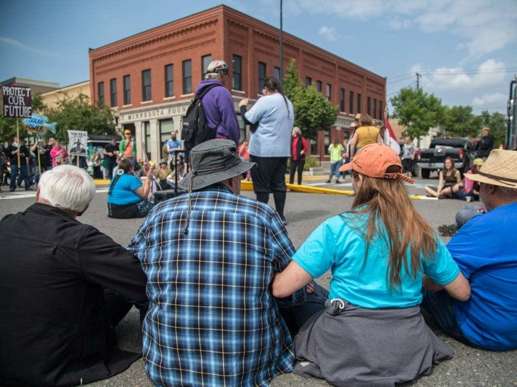 Protesters sit-in at the corner of 3rd Street and Beltrami Avenue.