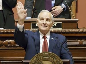 Minnesota Governor Mark Dayton waves and smiles