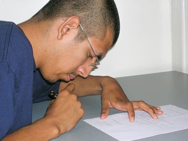 Mario Martinez taking a math test, June 2009.