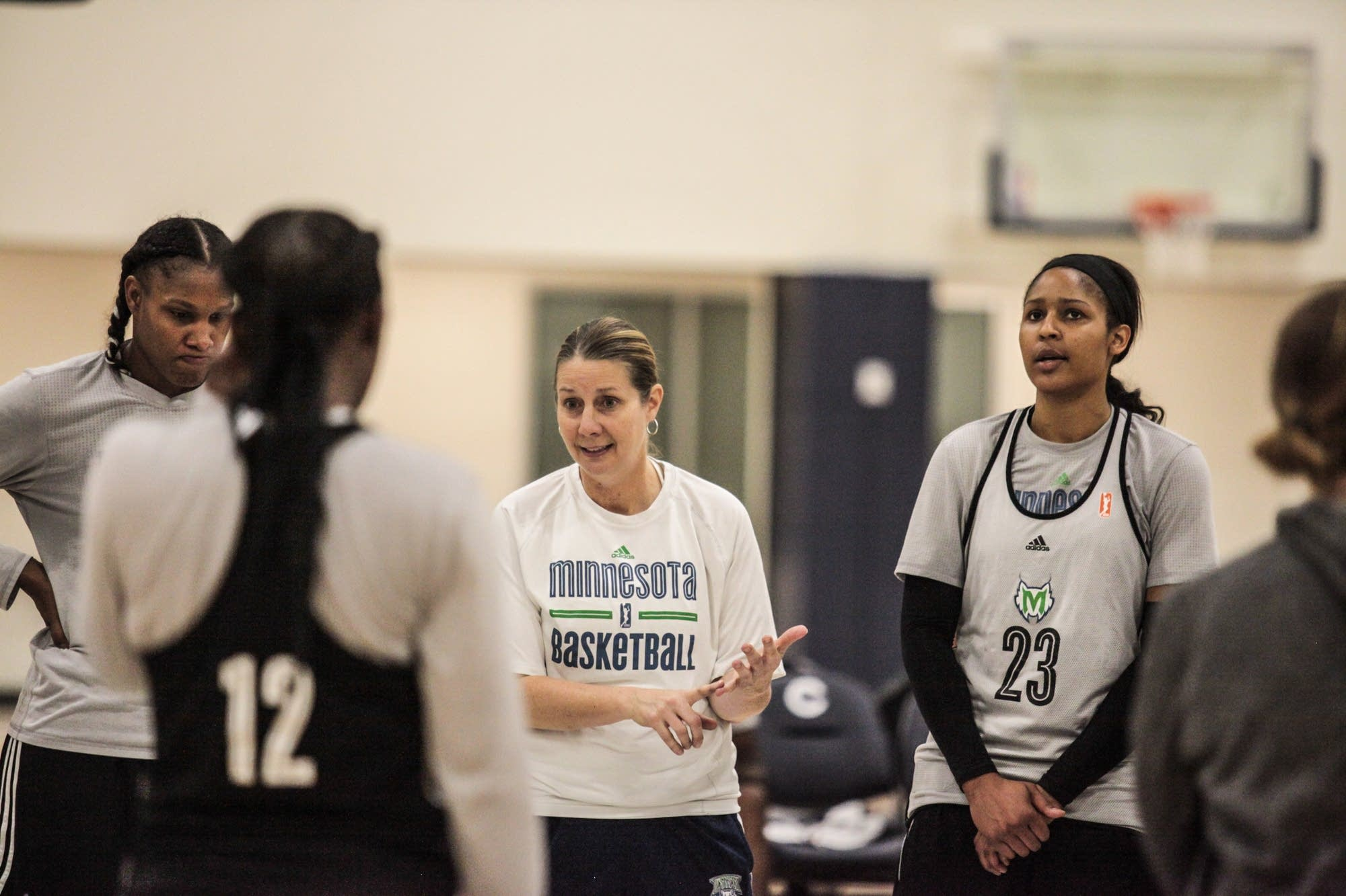 Minnesota Lynx head coach Cheryl Reeve talks to players.