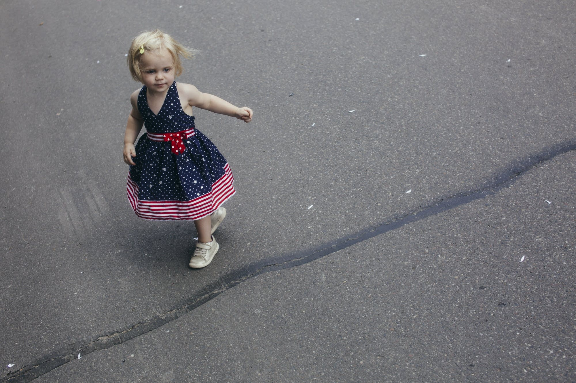 Two-year-old Alanee Brettingen dances in the street.