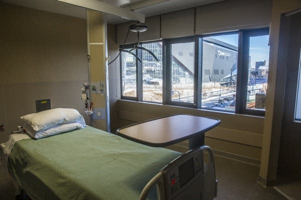 US Bank Stadium sits outside the window of an empty room in the burn unit.