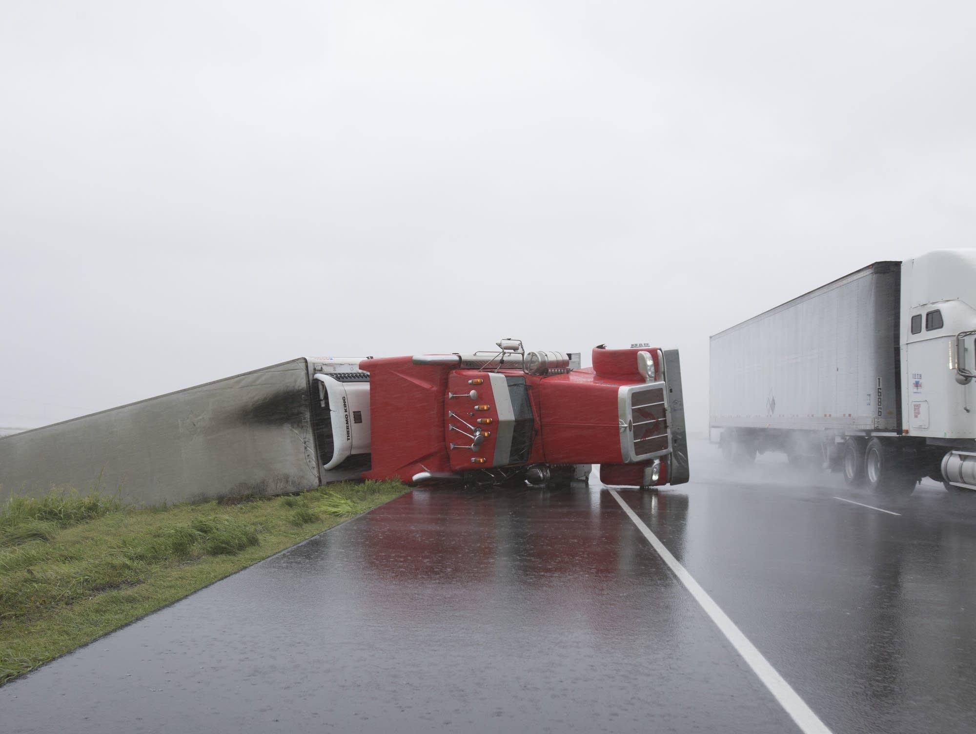 A big rig lies on it's side on Hwy 59 near Edna, Texas