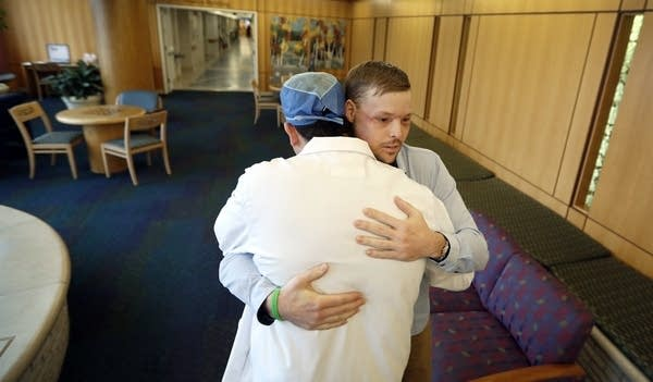 Andy Sandness is hugged by Dr. Samir Mardini