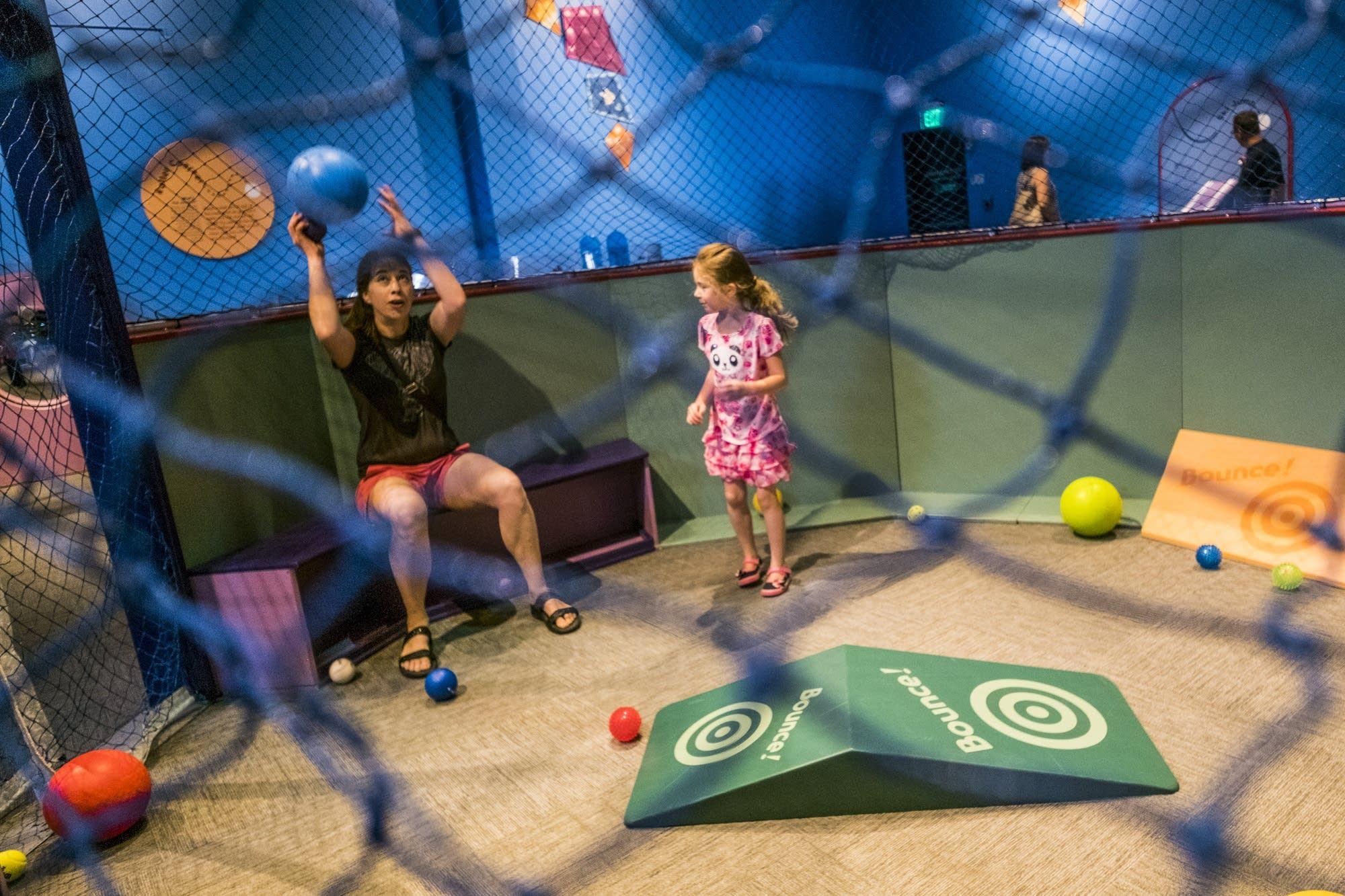 Briar and Jaimee Lamm play in the Ball-O-Rama room.