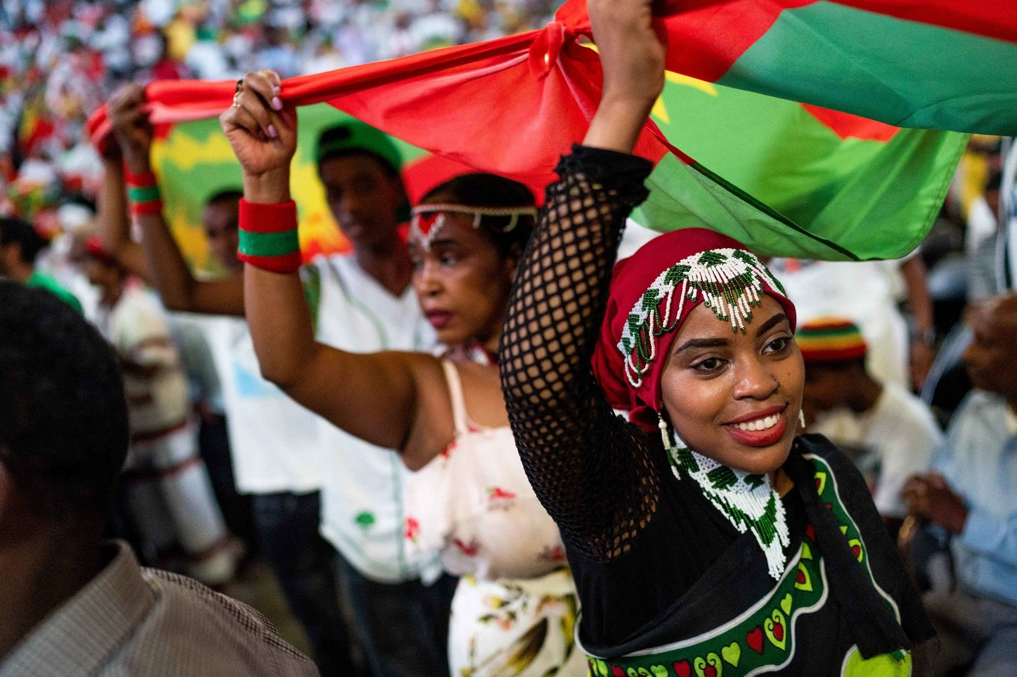 People carry giant Ethiopian and Oromo flags around.