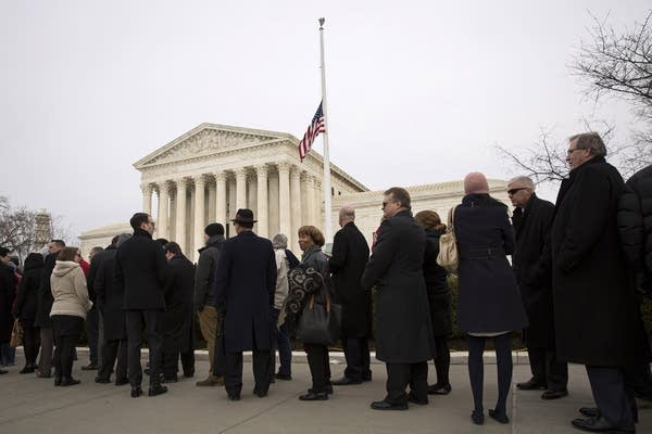 Visitors line up outside of the U.S. Supreme Court