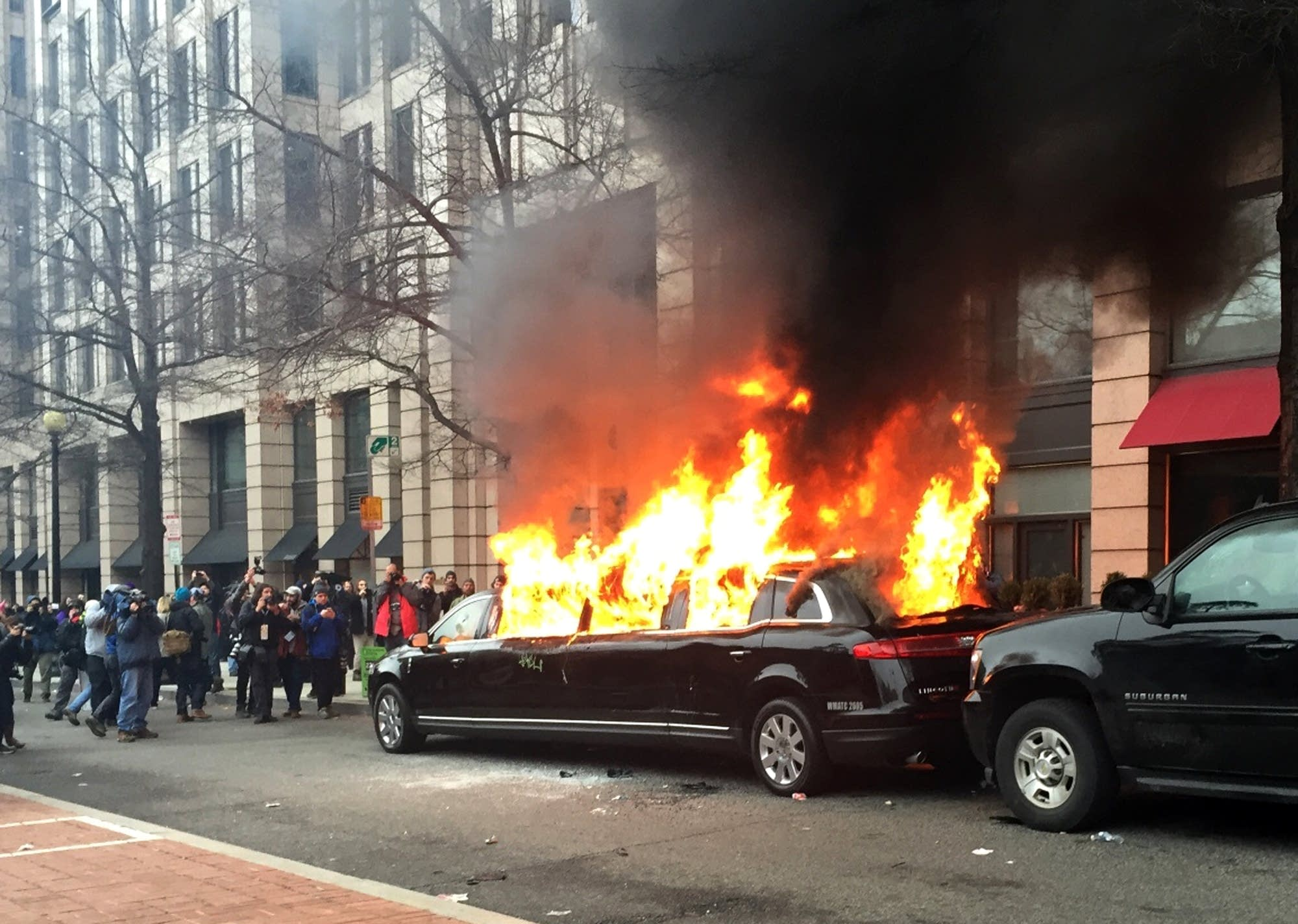 Protesters set a parked limousine on fire in downtown Washington, DC.