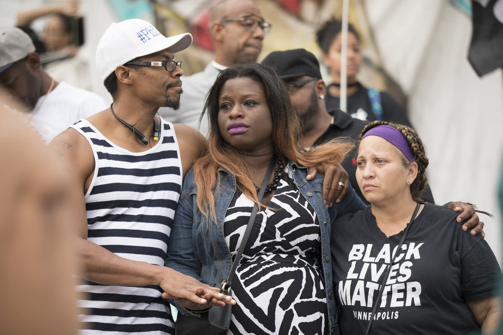 Marquis Armstrong, from left, Nekima Levy-Pounds and Cathy Jones listen.