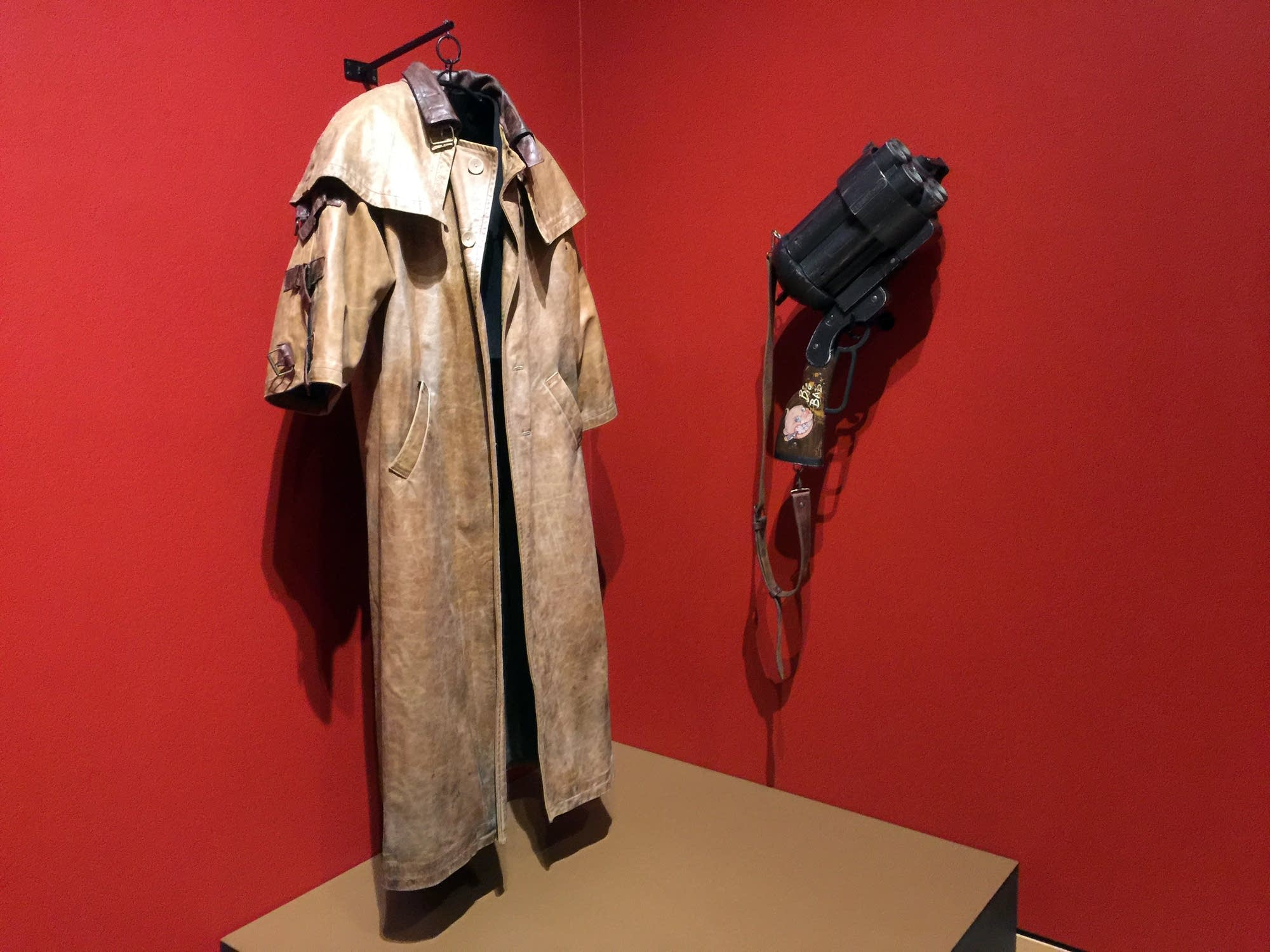 Film artifacts include Hell Boy's leather coat and 'Big Baby' gun.