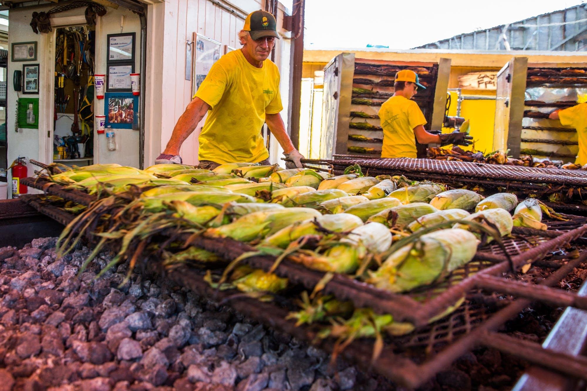 Brad Ribar flips roasting corn.
