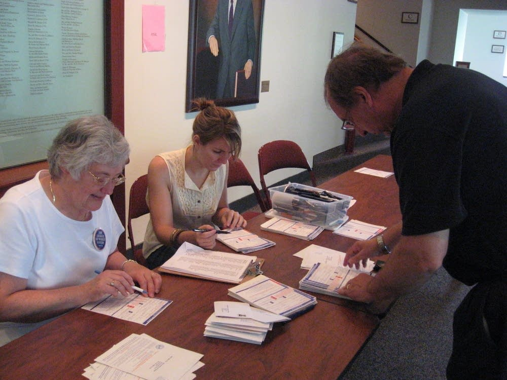 Checking voter registration cards