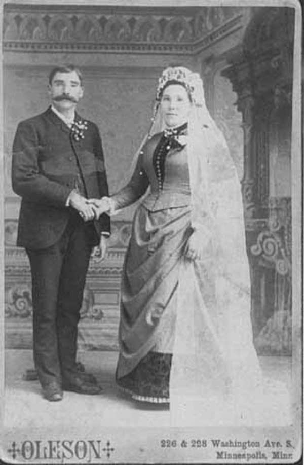 Bride and groom, studio portrait.