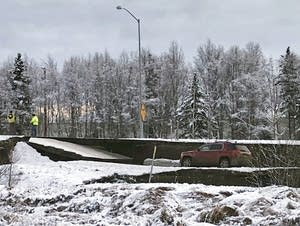 A car is trapped on a collapsed section of the offramp in Anchorage.