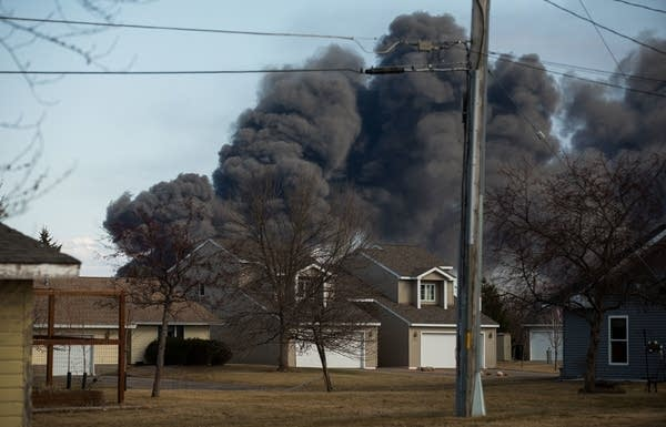 Black smoke from the refinery fire can be seen in neighborhood a mile away.