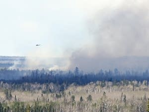 Fighting a fire near Hoyt Lakes, Minn.