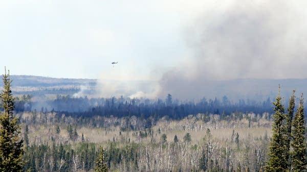 Fighting a fire near Hoyt Lakes, Minn.