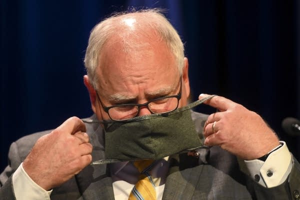 Gov. Tim Walz put back on his face mask