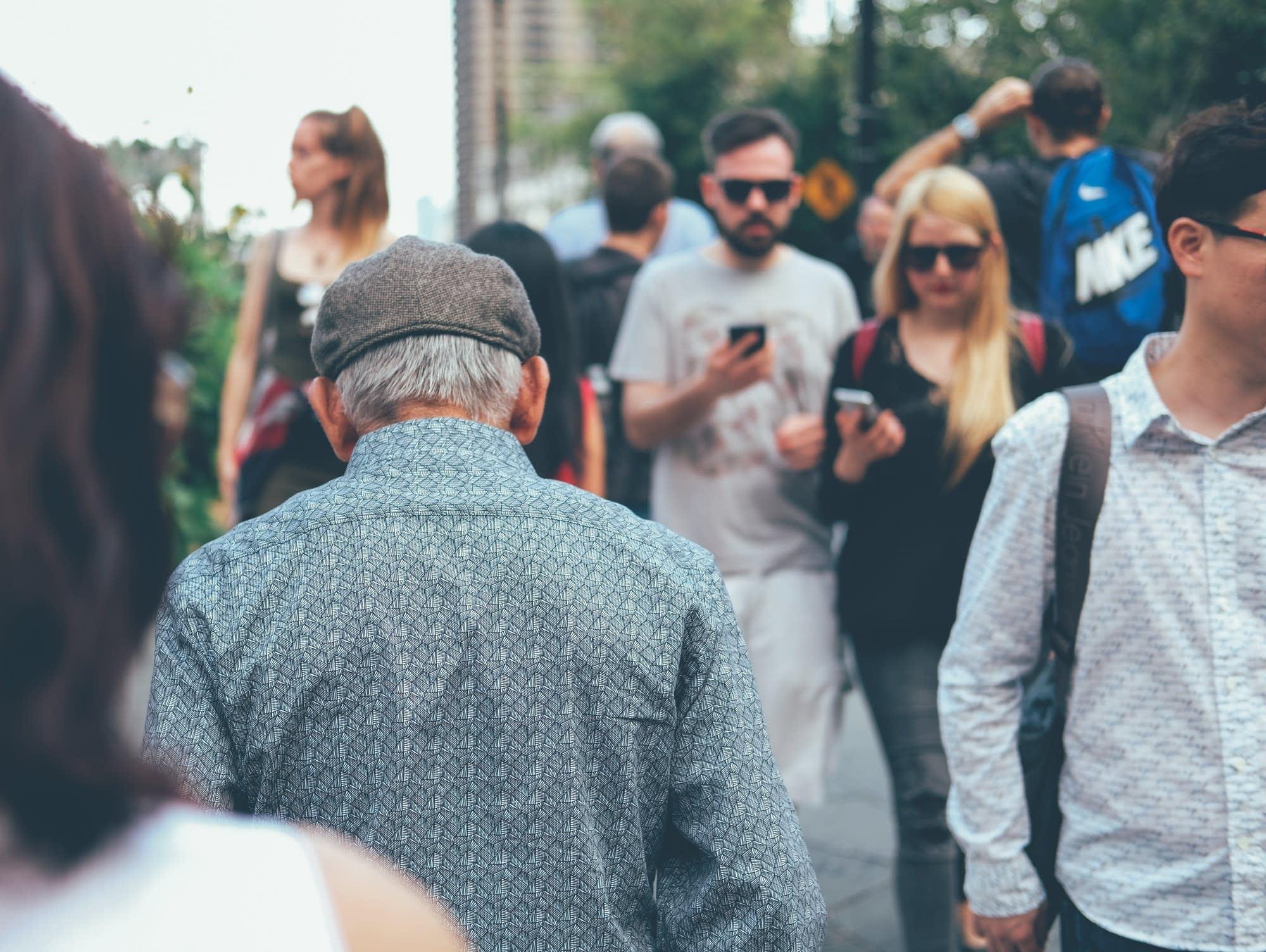 Older man in a crowd