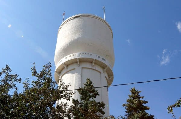 Stucco is missing from the rim of Brainerd's historic water tower.