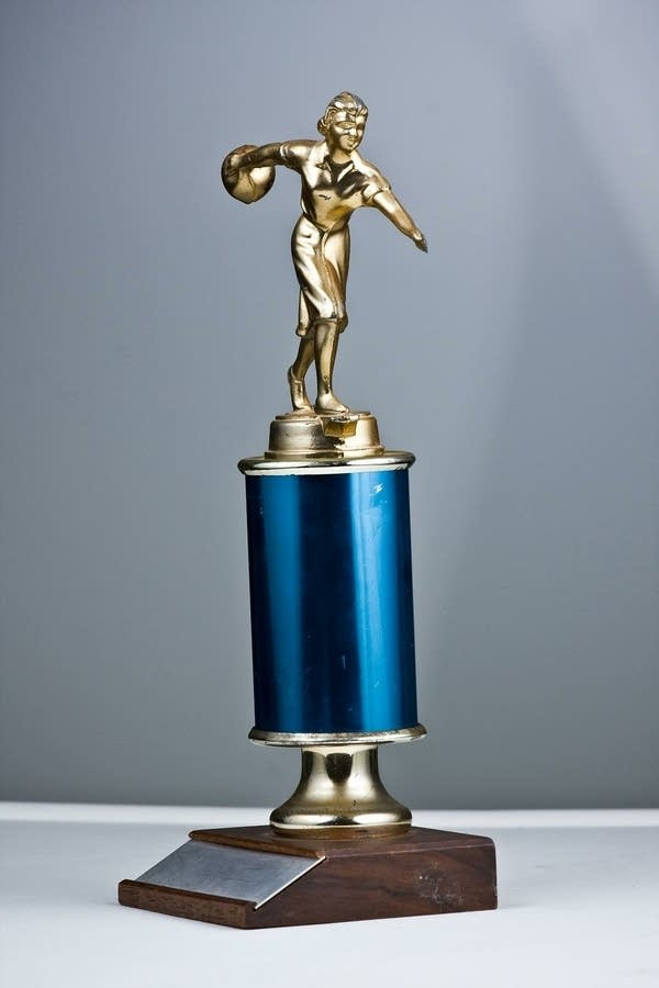 Smallish Bowling Trophy, blue base with statuette of bowler on top