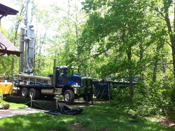 a well drilling truck in a yard