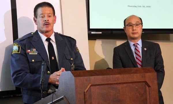 Police chief Thomas Smith, county atty. John Choi
