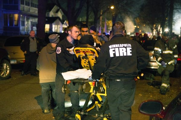 Paramedics took a wounded man to an ambulance.