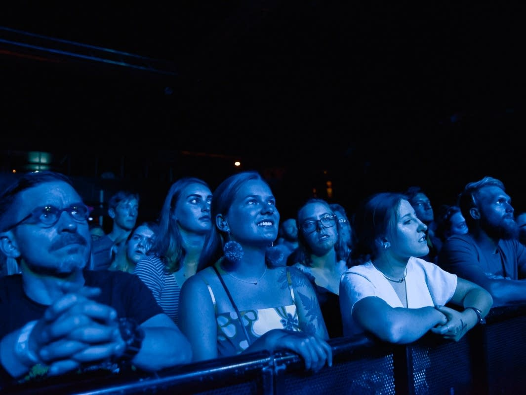 Fans watch Bad Bad Hats at First Avenue.