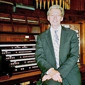 Gordon Turk seated at the console of the Robert Hope-Jones pipe organ.        image © by James G. Howes, July 8, 2007