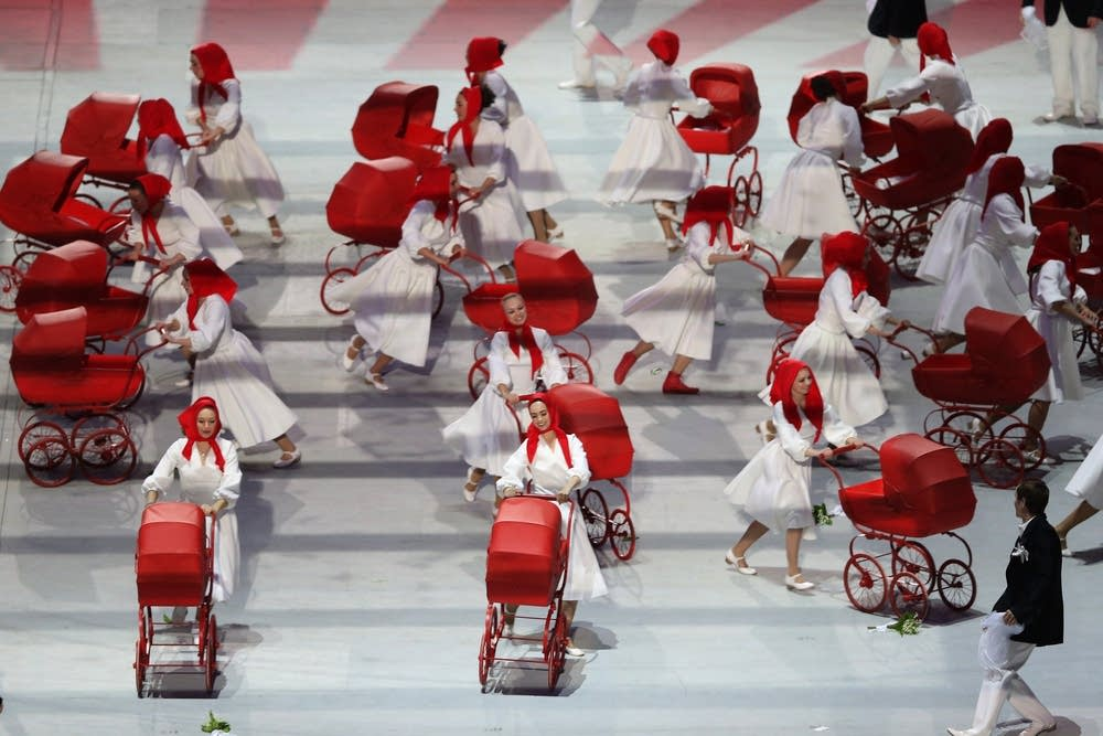 Actors with baby carriages perform