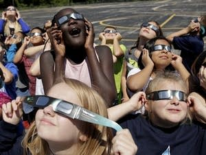 Students practice the proper use of their eclipse glasses.