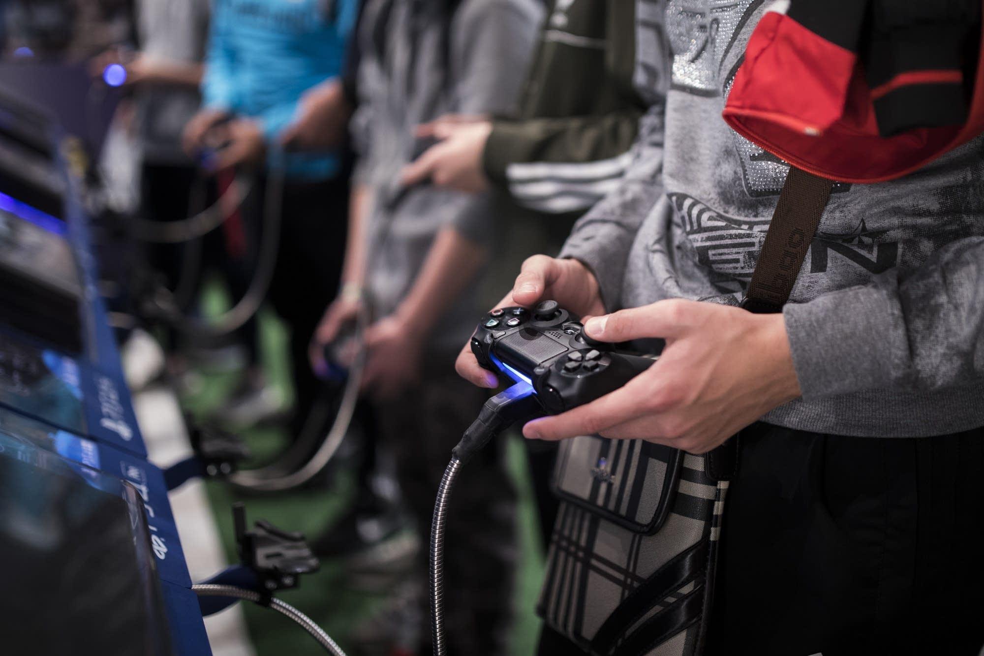 A man plays a game at the Paris Games Week.