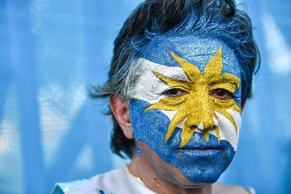 An Argentina fan poses