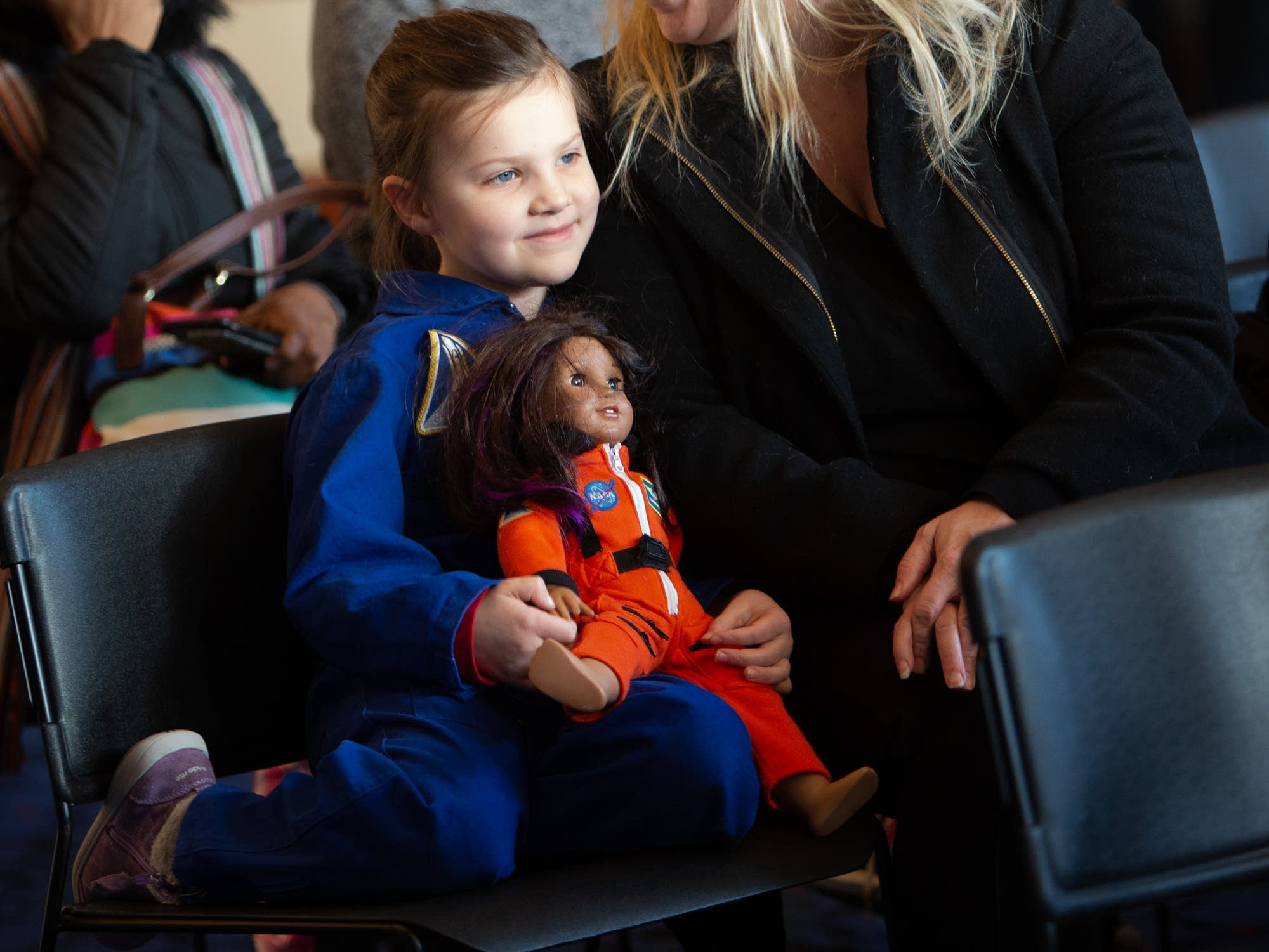 Samantha Kettleson, 6, and her doll, Lucy, attend the MLK Day youth rally.