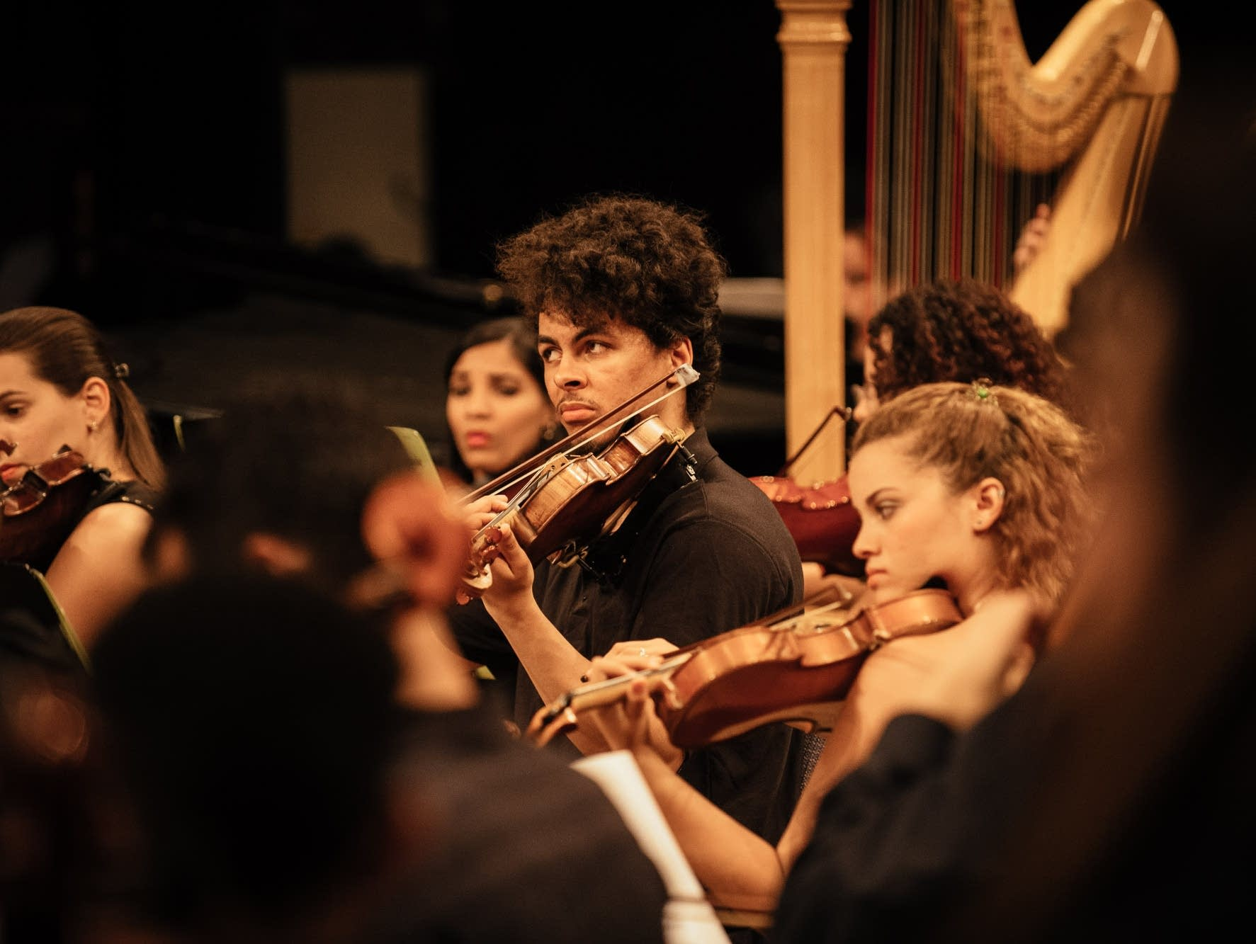 Violinists during CAYO's final performance
