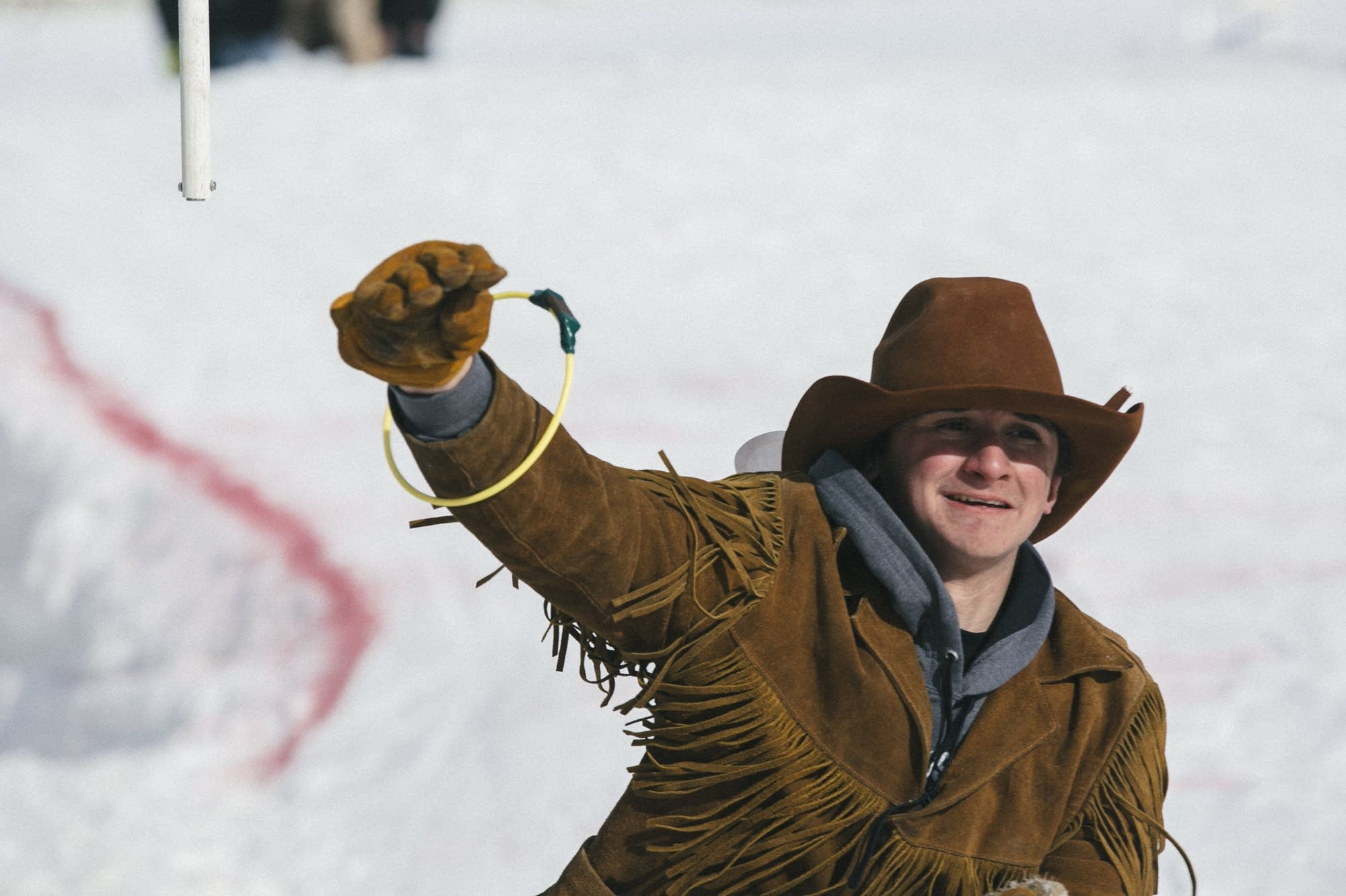 Dakota Morris reaches up to grab one of rings that skiers must collect.