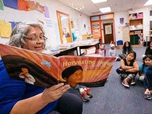 Roberta Rasmussen reads one of her favorites books to students.