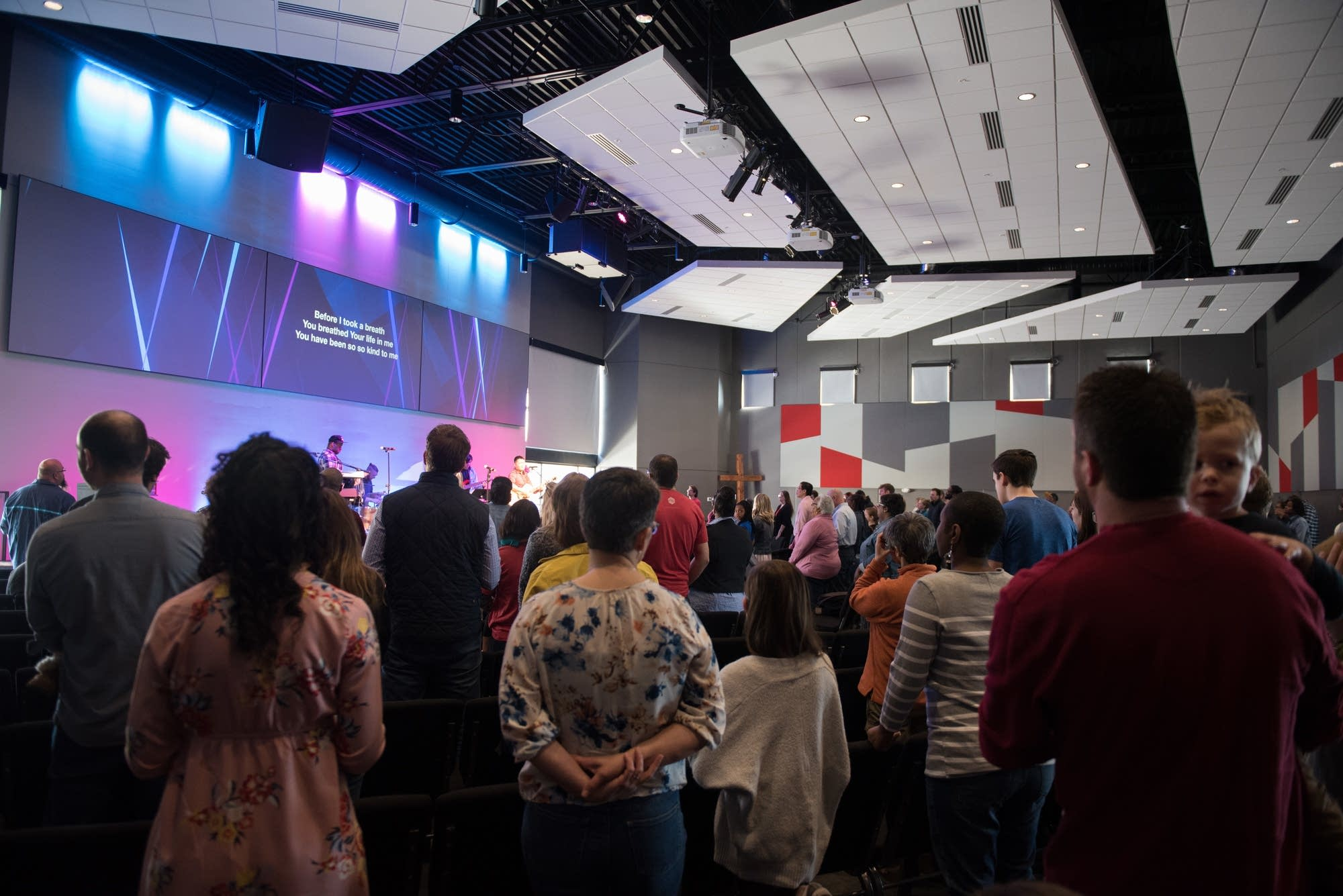 People listen to music during a Sunday morning worship service.