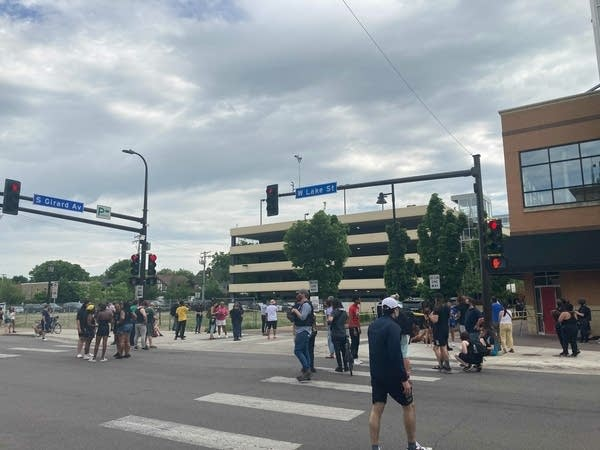 crowds gather in uptown after fatal shooting
