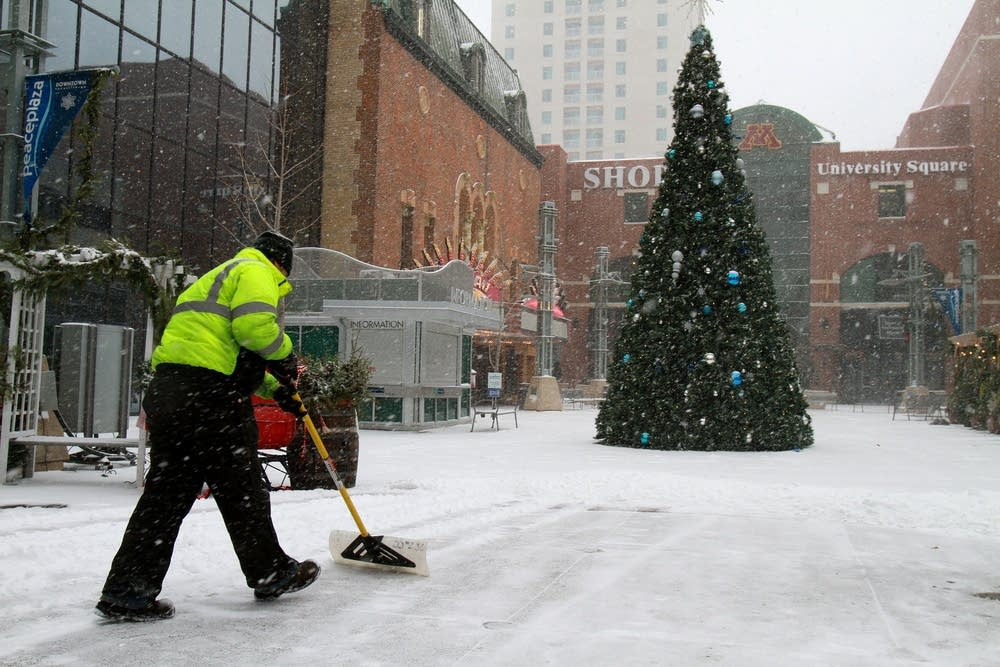Parks worker shovels snow in Rochester