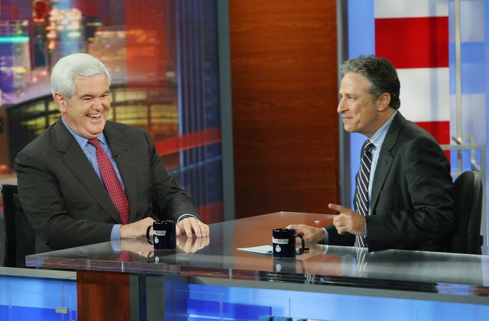 Jon Stewart and Newt Gingrich share a laugh