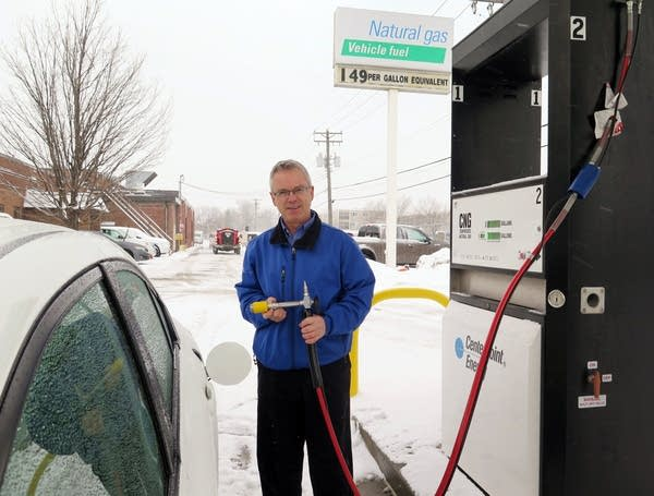 Mark Spanton displays the nozzle for compressed natural gas fuel.